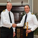 Captain Neil Wagstaff presents the sword to Steven Andrews (right)