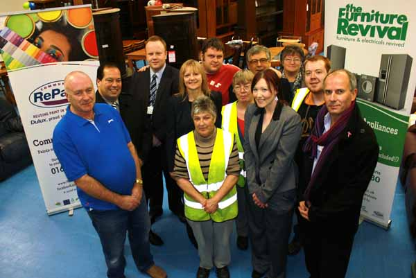 Councillors, volunteers and supporters celebrate Furniture Revival's 15th anniversary