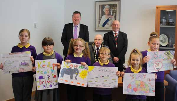 Pupils from Penllwyn Primary School with their poster designs. Also pictured is Caerphilly Council's Head of Engineering Services Terry Shaw (left), Mayor Cllr David Carter and Cabinet Member for Highways and Transportation Cllr Tom Williams (right).
