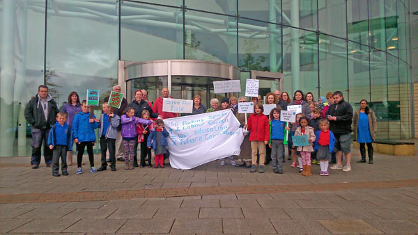 ANGRY: Protesters against the scheme demonstrate outside Caerphilly Council's offices in May