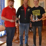 Sam (left) and Aaron Jones (right) receive their awards from 1989 and 1990 British Rally Champion David Llewellin