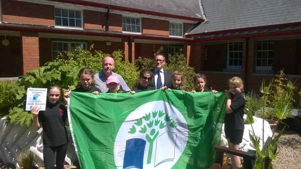 GREEN SPACE: Tim Lyons and Marc Yeoman with year 7 members of the eco-club