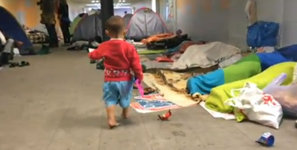 STRANDED: A little boy among desperate refugees at the international railway station in Budapest. Picture by BBC
