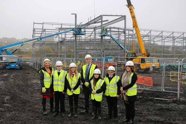 SITE VISIT: Council Leader Cllr Keith Reynolds (centre) joins others on a visit of the school