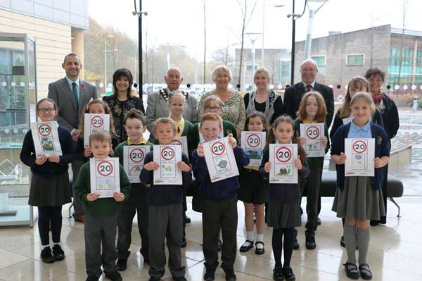 TWENTY IS PLENTY: Pupils from Ysgol Gymraeg Cwm Derwen and Rhiw-Syr-Dafydd Primary School with their road sign designs