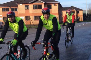 Radio 1 Greg James (centre) is all smiles as he makes his way along Van Road, Caerphilly, as part of his Sport Relief Challenge