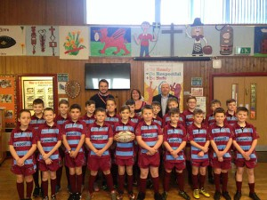 SUITED AND BOOTED: Pupils from Pla-y-Felin Primary School show off their kit