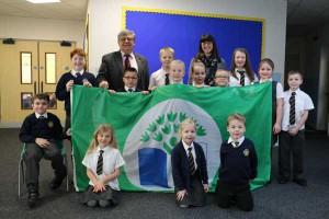 GREEN FLAG: The pupils of Ysgol Gymraeg Penalltau with Cllr Ken James and headteacher Andrea Woods
