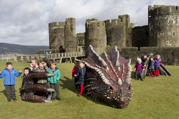 SNARED: Children from Ysgol Ifor Bach in Abertridwr enjoy themselves at the Castle dragon