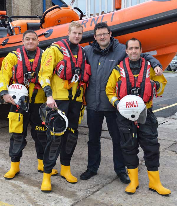 ALL SMILES: Mike Dooley (centre) with (left to right) Porthcawl RNLI volunteers Simon Emms, Ross Purchase and Matthew Picton