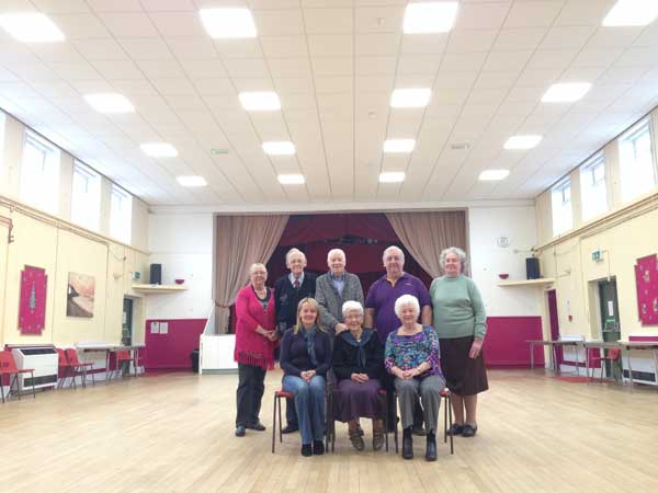 The committee of Penyrheol Community Centre standing under the new ceiling