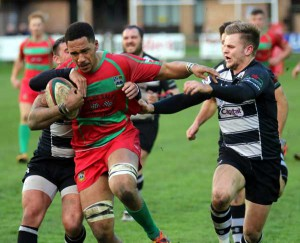 BREAK: Bedwas' Rhys Verley tries to hold off Keys tacklers during his side's close defeat