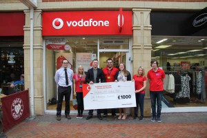 Caerphilly Observer editor Richard Gurner (left), Vodafone Store Manager Darren Hammer (centre) with Disability Can Do's Tom Clark (centre left) and Kate Howell (centre right) together with staff