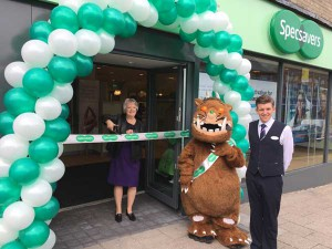Specsavers co-founder, Dame Mary Perkins cuts the ribbon to open the new shop in Caerphilly town