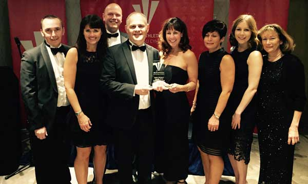 RUNAWAY SUCCESS: Caerphilly Runners collected their award