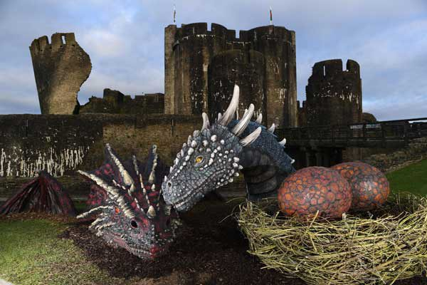 Caerphilly Castle's two resident dragons, Dewi and Dwynwen. Photo by Cadw.