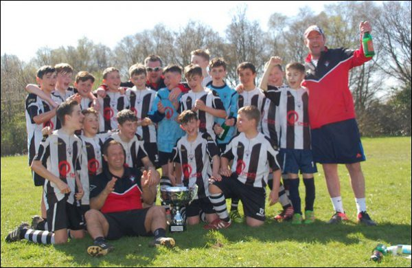 UNDEFEATED: Fleur-de-Lys under-13s celebrate winning every match of their Islwyn Junior League season