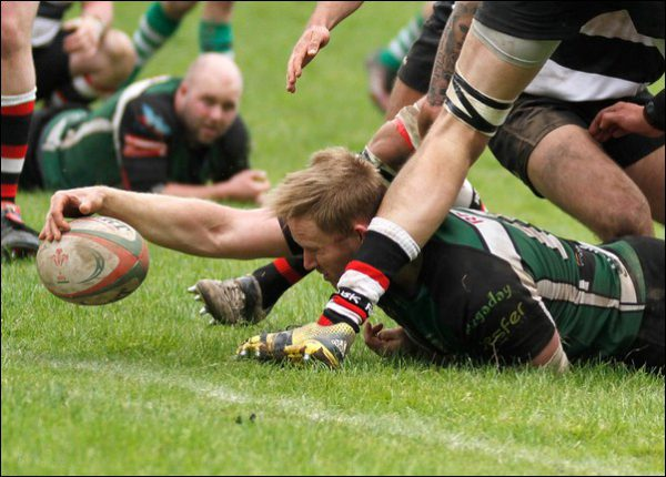 Matthew Hurley dives over for Caerphilly during their narrow 22-21 defeat to Usk