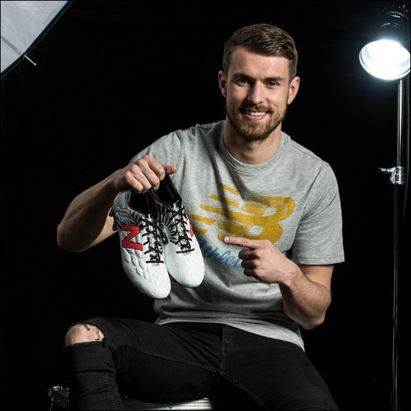 Caerphilly-born Arsenal midfielder Aaron Ramsey with his customised boots. Photo by New Balance