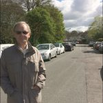 Rob Barnes and some of the parked cars on St Martin's Estate, Caerphilly