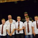 AWARD: Simon Grist, back left, at BTM United's presentation evening with a selection of the club's youth players