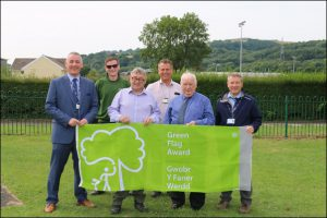 Leader of Caerphilly County Borough Council, David Poole, second from right, at Ystrad Mynach Park, a recipient of the Green Flag Award.