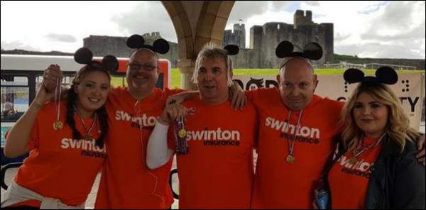 TEAMWORK: Swinton staff static-cycled the distance to Paris