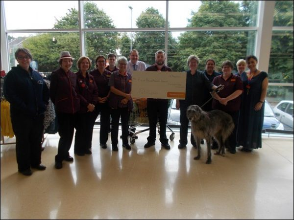 Staff at Sainsbury's Pontllanfraith present the Four Paws Animal Rescue charity with a cheque