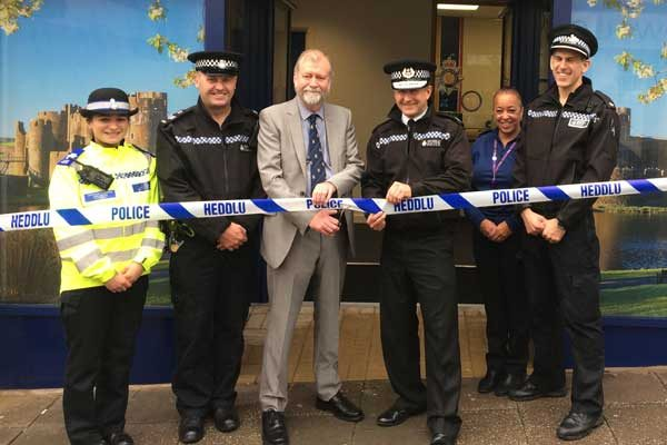 Gwent Police and Crime Commissioner Jeff Cuthbert cuts the police tape alongside Chief Constable Julian Williams