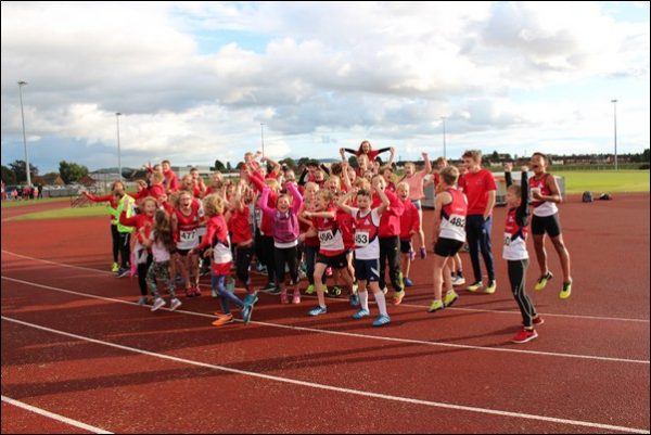 ECSTATIC: Rhymney Valley AC athletes celebrate top spot
