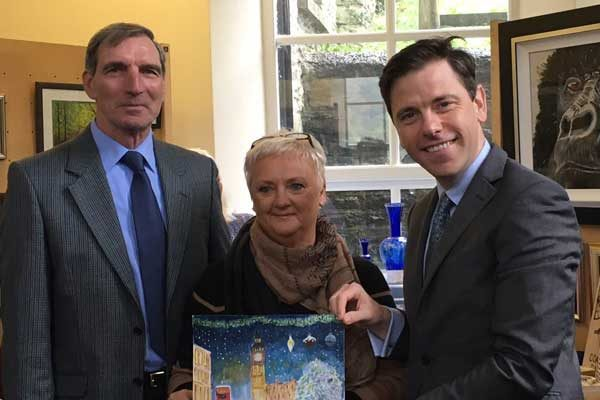 CHRISTMAS SPIRIT: Islwyn MP, Chris Evans, with Cllr Williams and Wendy Frowen, whose art was chosen for the MP's card