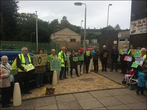Activists from the Lower Sirhowy Valley Residents Group voice their opposition to proposals for a waste treatment plant at the Blackwood Rugby Club, where an investigation is underway