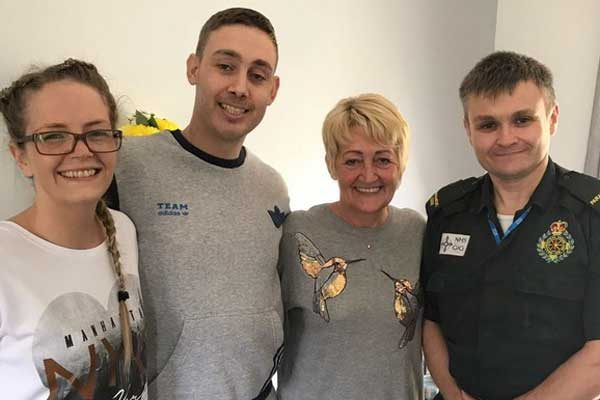 Left to right are Ceri-Ann Cleverly, Rhys Parker, Rhys' mum Susan and paramedic Mark Sutherland