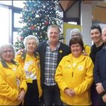Marie Curie volunteers with actor Mark Lewis Jones, centre, an ambassador with the charity, and Caerphilly Visitor Centre Manager Martin Cook, right