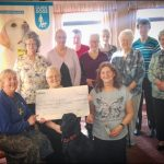 Members of Young at Heart and Friends in Trethomas present their cheque to Guide Dogs Cymru