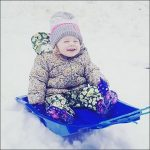 23-month-old Gracie Midgley enjoying the snow in Abertridwr