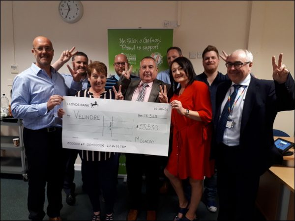 Megaday organisers present a cheque to Velindre Cancer Centre