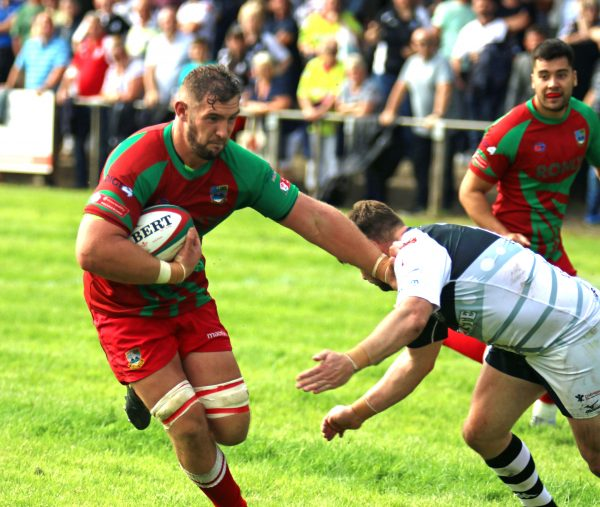 James Thomas fends off a Pontypridd tackler. Picture by Ian Lovell