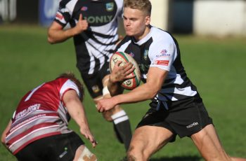 George Gasson takes on a Cross Keys defender