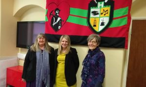 Minister for Housing and Local Government, Julie James AM, left, with Deputy Housing and Local Government Minister, Hannah Blythyn, and Caerphilly Miners Centre secretary Katherine Hughes, right