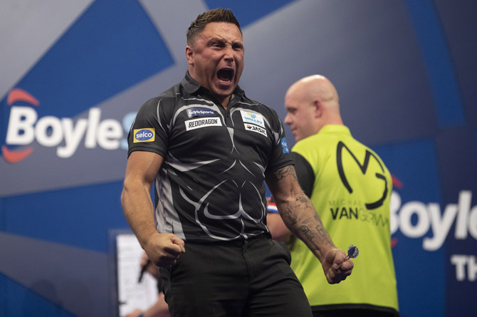 Gerwyn Price celebrating his semi-final victory over Michael van Gerwen at this year's Grand Slam of Darts, which he went on to win