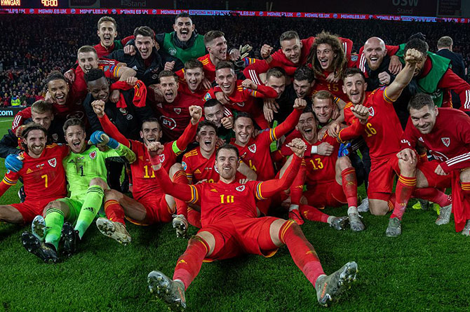 Aaron Ramsey, front centre, celebrated Euro 2020 qualification with his Wales teammates