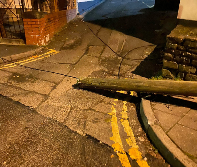 Picture of a telegraph pole knocked over by a white Nissan Juke which crashed in Caerphilly on December 1, 2019.