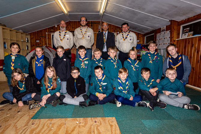 Pontllanfraith Rotary Club President Faisal Abu-Moghli with scout leaders Lee Griffiths, Sebastian White and Gareth Haywood alongside young scouts