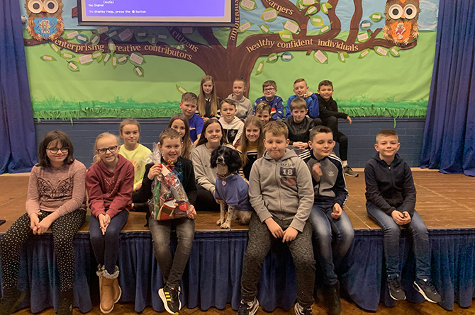 Tir y Berth Primary School pupils gave a Christmas hamper to Daisy the dog