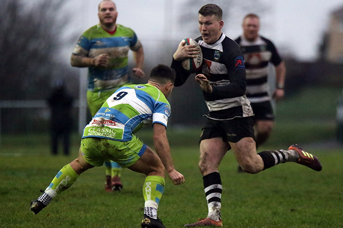 Bedwas' Lewis Bowden looks for a way past Bargoed scrum half James Leadbeater
