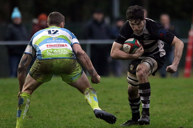 Bedwas' Owen Jones takes on Bargoed's Darren Humphries.