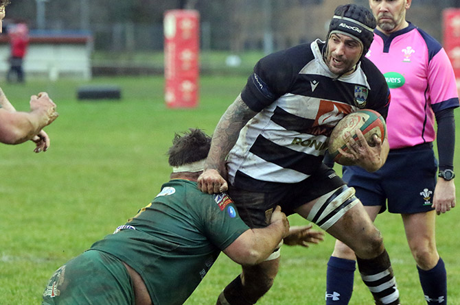 Bedwas captain Jonathan Armitage looks to escape thetackle of Beddau's Ben Lee