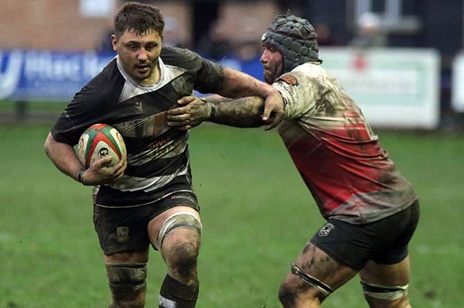 Bedwas' Dale Rogers gets past Cross Keys' Spencer Gibson