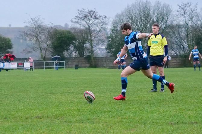 Bargoed's Steffan Jones taking a kick against Maesteg Quins
